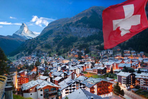 swiss-town-with-flag-of-switzerland-swiss-alps-matterhorn-in-background